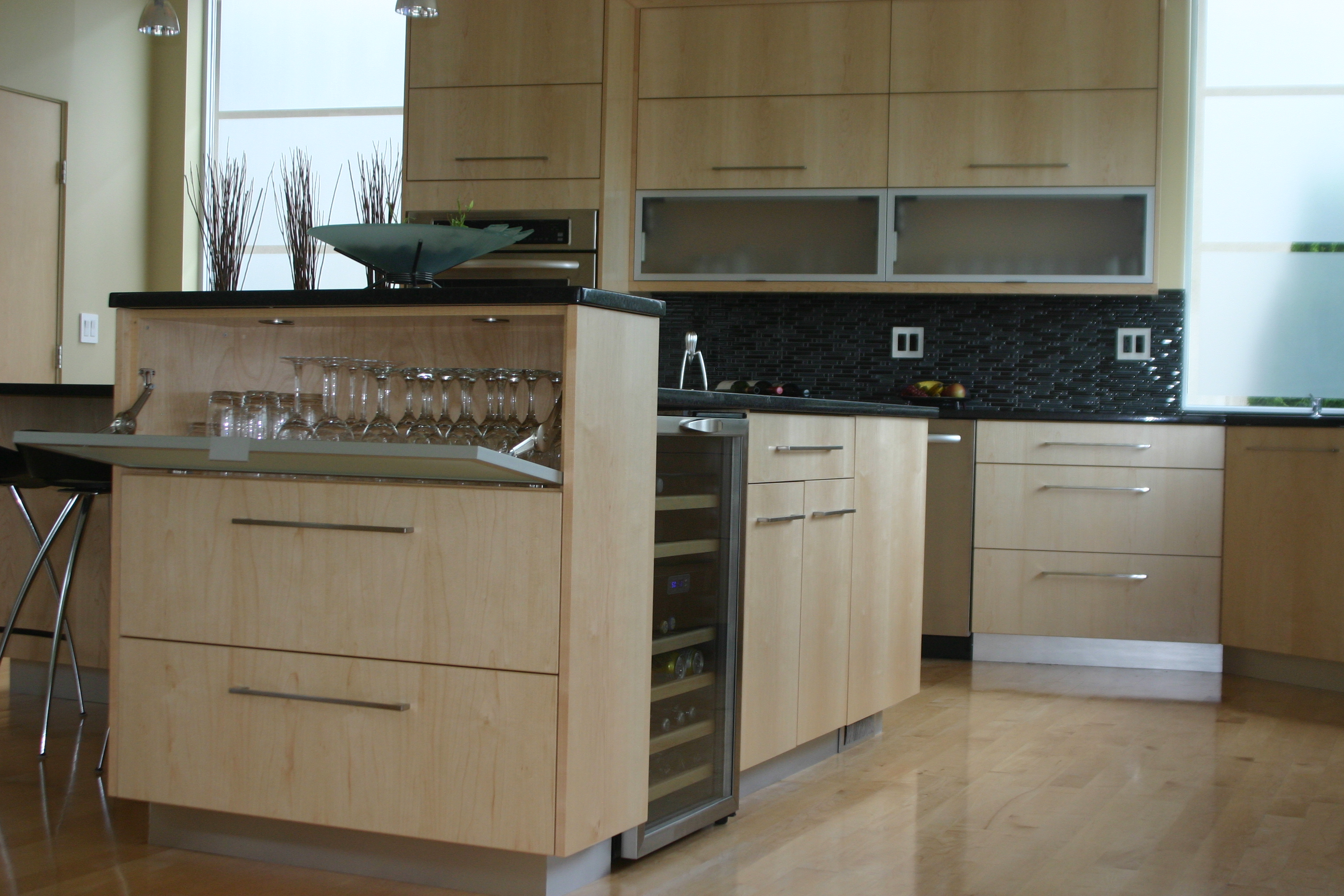 New Aventos Lift System and Display Cabinetry in Eastern Maple Kitchen